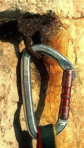Old piton with carabiner clipped to it